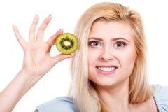 Woman holding green kiwi fruit Stock Photos