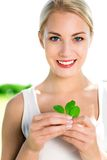 Woman holding green leaves Stock Image