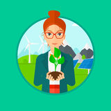 Woman holding green small plant. Royalty Free Stock Photos