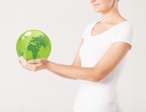 Woman holding green sphere globe. Close up of woman holding green sphere globe Royalty Free Stock Image
