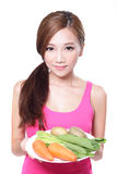 Woman holding green vegetables and carrots Royalty Free Stock Photos