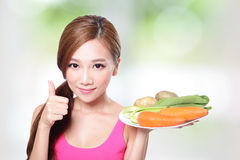 Woman holding green vegetables and carrots Royalty Free Stock Photography