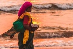 Woman Holding Grey Bowl Near Seaside Stock Photo