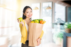 Woman holding groceries bag in market Royalty Free Stock Image