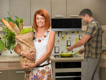Woman holding groceries in paper bag Stock Photos