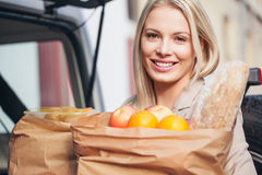Woman Holding Groceries Stock Photos