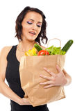Woman holding grocery bag Stock Photography