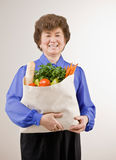 Woman holding grocery bag full of fresh fruit Stock Photography