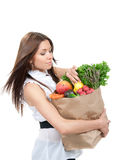 Woman holding a grocery shopping bag Stock Images