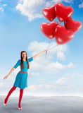 Woman holding a group of heart shaped balloons Royalty Free Stock Photography