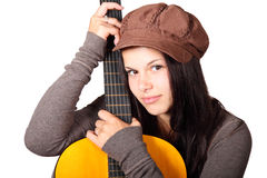 Woman holding guitar. Young woman holding acoustic guitar isolated on white background Royalty Free Stock Photos