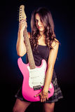 Woman Holding Guitar royalty free stock photography