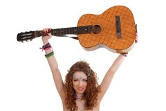 Woman holding guitar under her head Royalty Free Stock Image