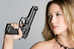 Woman Holding Gun royalty free stock photography