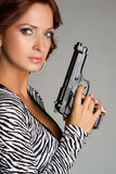 Woman Holding Gun Stock Images