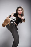 Woman holding gun. Sexy woman holding gun on gray Stock Photography