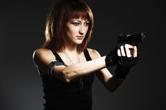 Woman holding gun Stock Photography