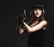 Woman holding gun Royalty Free Stock Photos