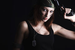 Woman holding gun Royalty Free Stock Images