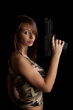 Woman holding gun Royalty Free Stock Photo