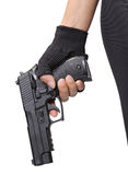 Woman holding gun. Image of woman holding her black pistol on white background royalty free stock photos