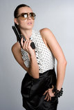 Woman Holding Gun. Beautiful sexy woman holding gun Royalty Free Stock Images