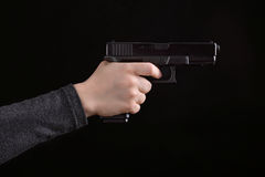 Woman holding a gun Stock Image