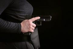 Woman holding a gun stock photos