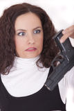 Woman holding gun in fear Stock Image