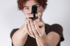 Woman holding a gun Stock Photography