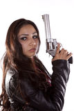 Woman holding gun looking back Royalty Free Stock Photography