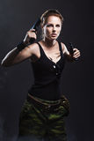 Woman holding gun with smoke Royalty Free Stock Image