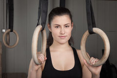 Woman holding gymnastics rings crossfit Stock Images