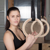Woman holding gymnastics rings crossfit Stock Photos
