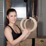Woman holding gymnastics rings Stock Photo