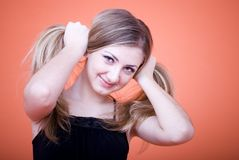 Woman holding hair Stock Photos