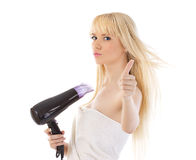 Woman holding hair dryer and giving thumbs up. Portrait of beautiful woman holding hair dryer and giving thumbs up over white stock photo