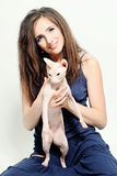 Woman holding Hairless Cat. Woman holding Hairless Sphynx Cat Stock Photography