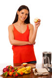 Woman holding half of apple in hand preparing healthy fruit smoo Stock Photos