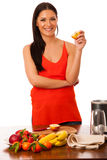 Woman holding half of apple in hand preparing healthy fruit smoo Stock Image