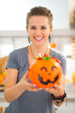 Woman holding halloween bucket full of trick or treat candy Stock Photography