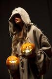 Woman holding halloween pumpkins stock photo