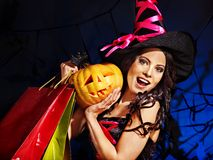 Woman holding Halloween shopping bag. Happy woman holding Halloween shopping bag Royalty Free Stock Images