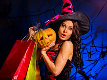 Woman holding Halloween shopping bag. Royalty Free Stock Image