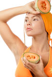 Woman Holding Halves Of Cantaloupe Stock Images