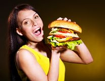 Woman holding hamburger. Royalty Free Stock Images