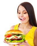 Woman holding hamburger. Royalty Free Stock Photos