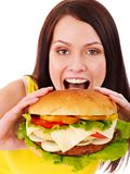 Woman holding hamburger. Royalty Free Stock Photography