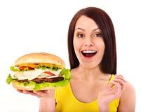 Woman holding hamburger. Royalty Free Stock Image