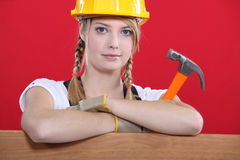 Woman holding a hammer Stock Photo